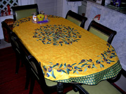 oval tablecloth coated with olive design