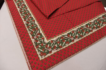 red tablecloth with olive border