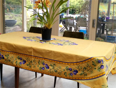 8 seater Provencal tablecloth with oval design of purple figs on a yellow background.