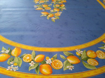 blue coated tablecloth with lemon design
