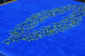 wipe over tablecloth with olive design