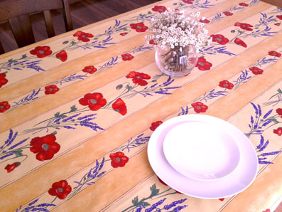 treated French tablecloth with red poppies